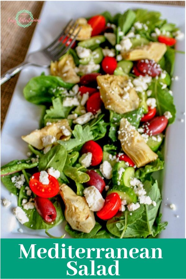 One of the best salad recipes with mixed greens, marinated artichoke hearts, Kalamata olives, tomatoes, cucumbers, feta cheese and the text Mediterranean Salad