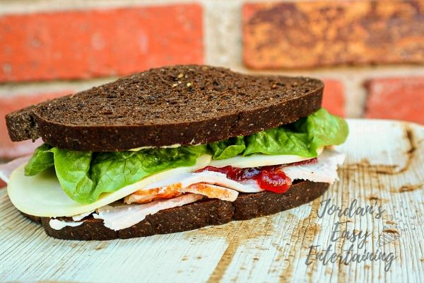 simple turkey sandwich recipe with cranberry sauce, cheese, and lettuce