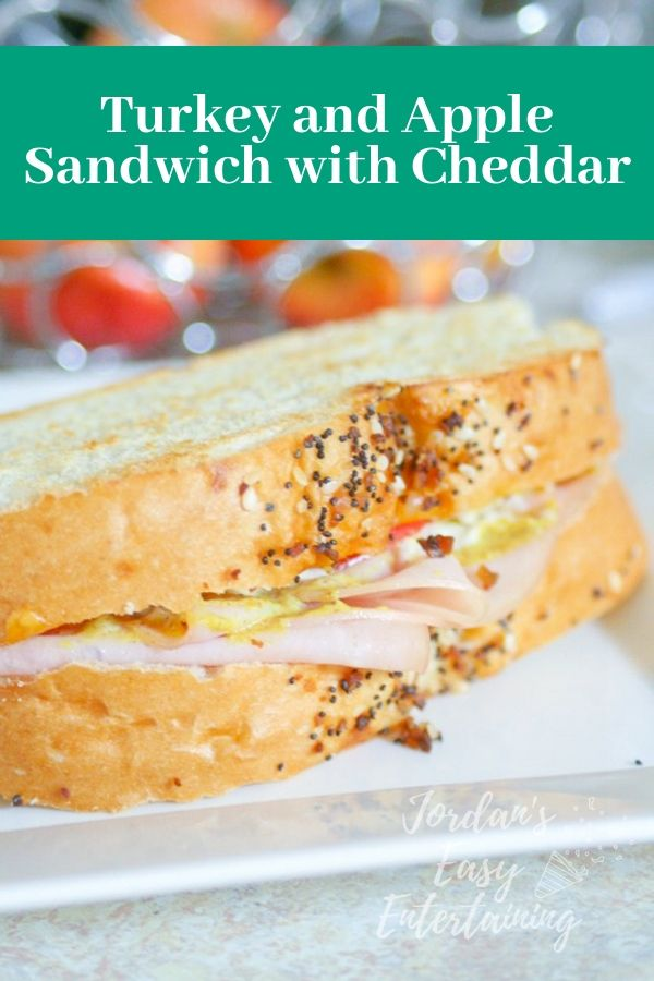 a delicious roasted turkey sandwich with apple and cheddar cheese
