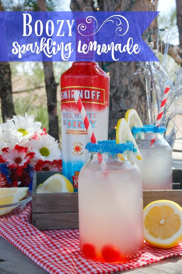 This super refreshing boozy sparkling lemonade is sure to be hit at your cocktail party. Made with Smirnoff Red White and Berry vodka, sparkling lemonade, and a splash of cherry juice it's an easy pitcher drink to whip up in no time. #sponsored Smirnoff Red White and Berry recipes | lemonade alcohol drinks | lemonade cocktail