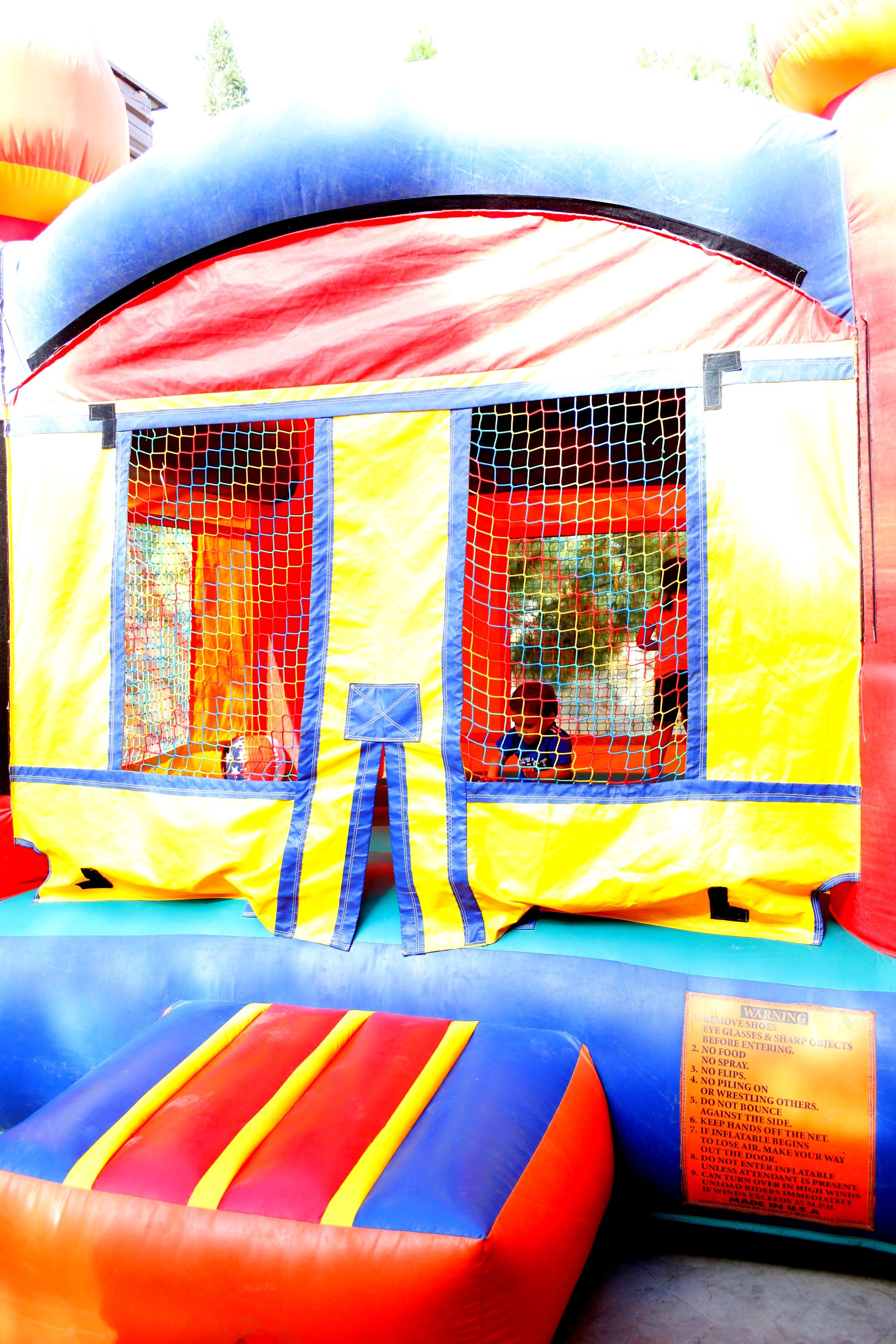 Keep the kids entertained for hours at your party with a bouncy house