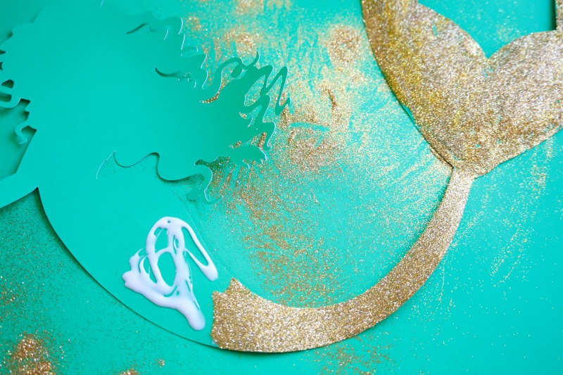 Make this DIY mermaid backdrop for your Under the Sea or Mermaid party with this easy to follow tutorial