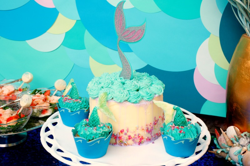 These adorable mermaid tail cupcakes are easy to make with this tutorial and the perfect addition to your Under The Sea party.