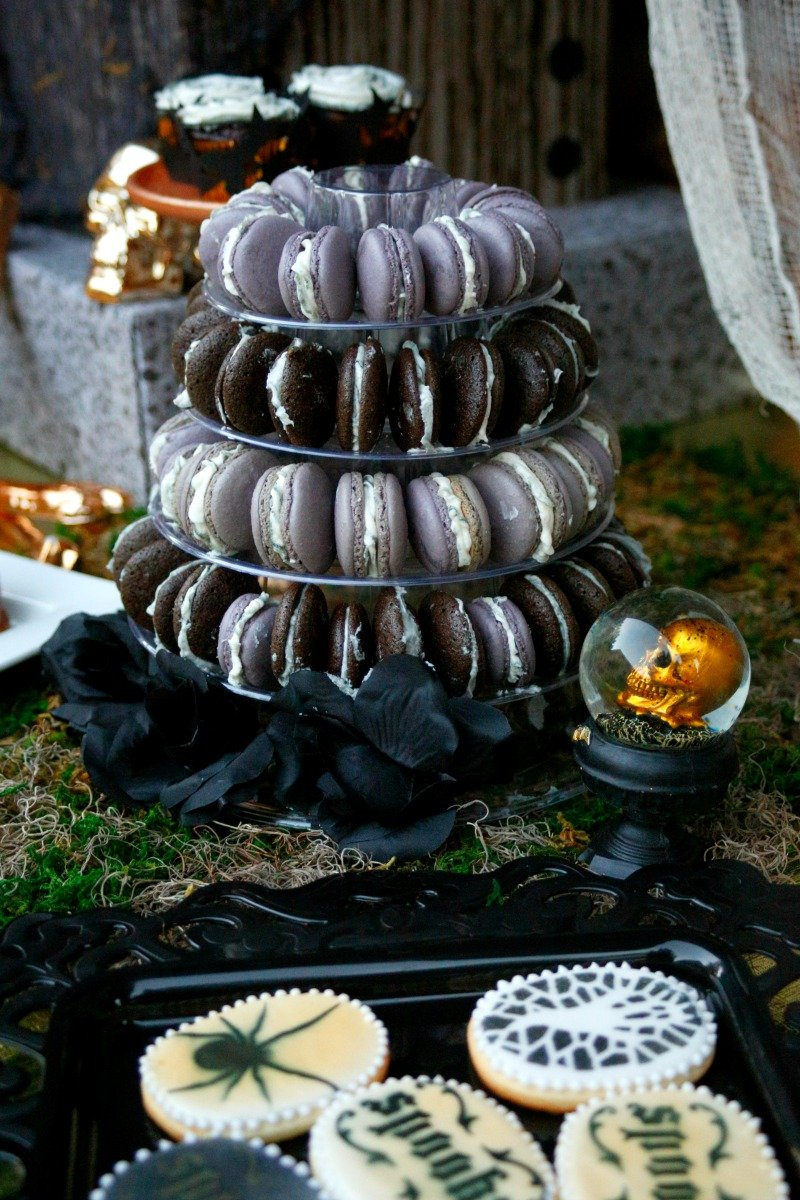 Macarons on the dessert buffet at a creepy but beautiful black and gold Halloween dinner party