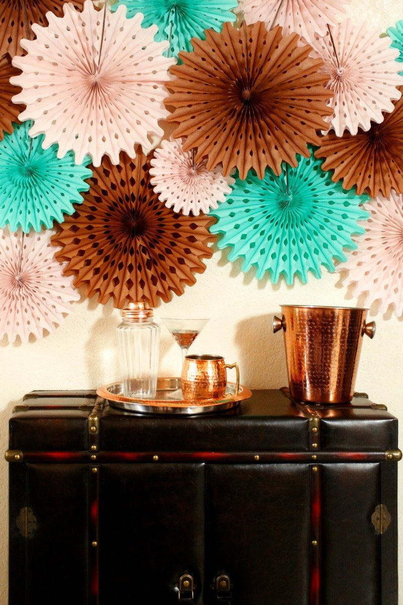Paper fans in brown, aqua, and blush for a unique #friendsgiving party setup [sponsored]