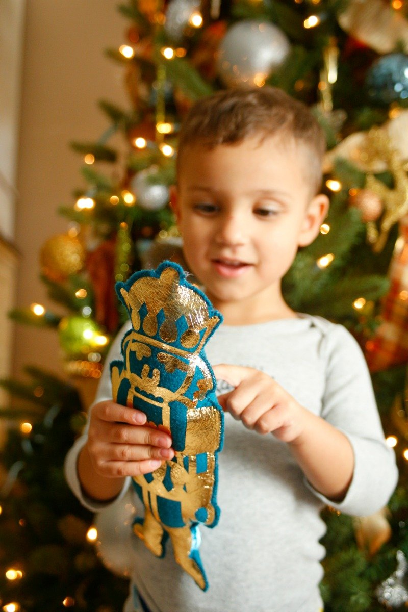 Make this adorable stuffed Nutcracker toy with your Cricut Maker in under 20 minutes with this easy to follow tutorial #CricutMade #CricutHoliday #ad @Cricut