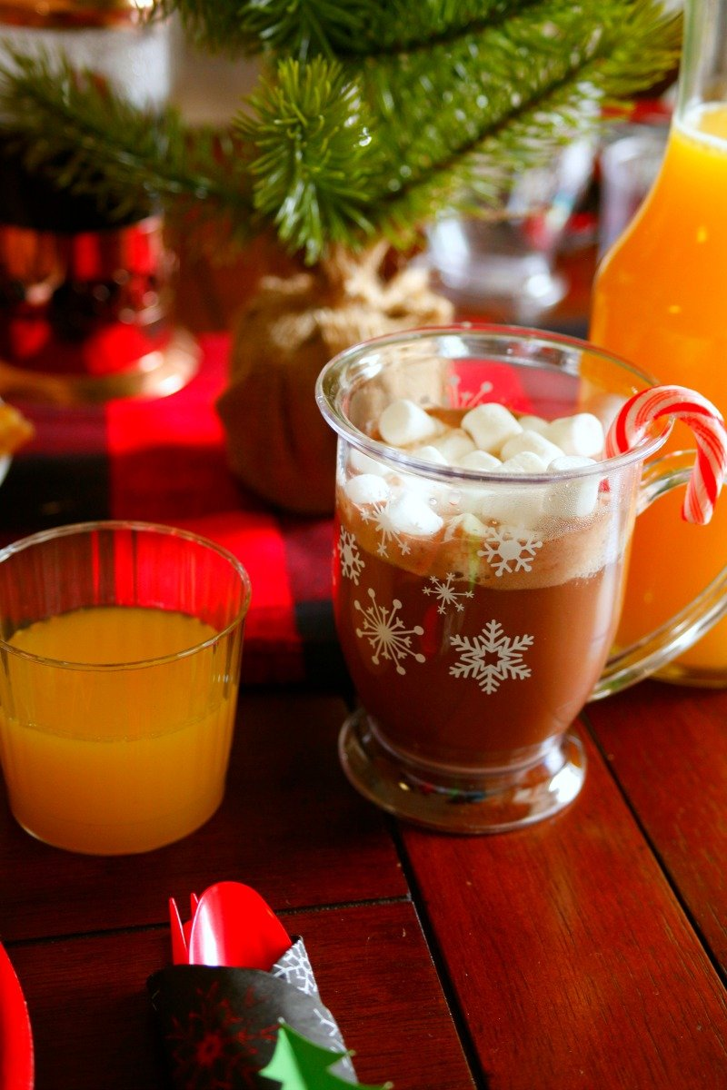 Make your cocoa extra special this Christmas with mini marshmallows and a candy cane! #orientaltrading