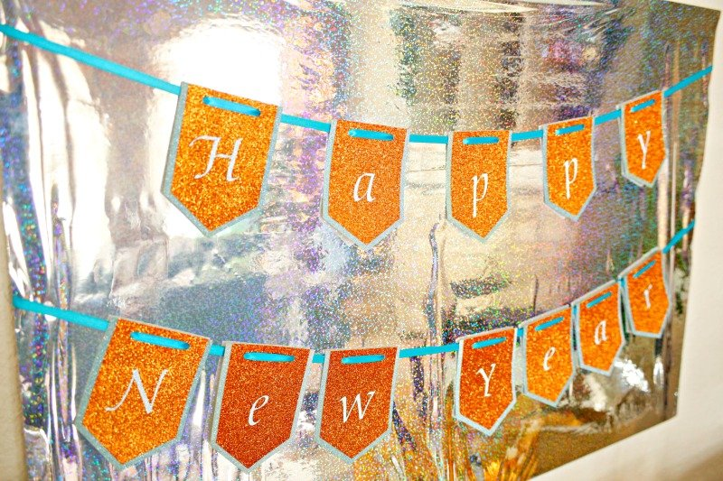 Customize your New Year's Eve Party with Cricut and see how to make these fun party decorations. Plus enter for your chance to win a Cricut Maker. #CricutMade #CricutHoliday [ad]