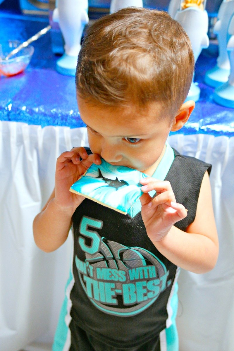 Having fun at a shark party with airbrushed shark silhouette sugar cookies #sharkparty