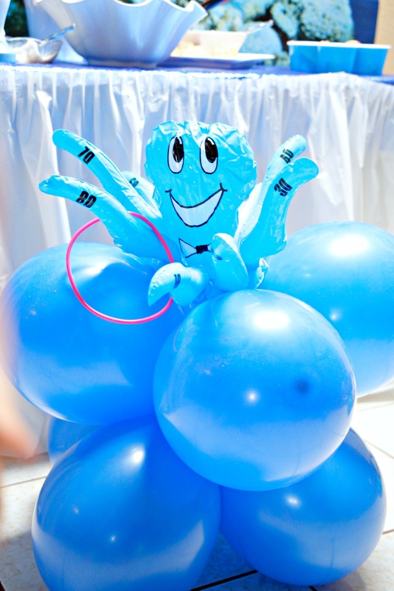 Super cute Octuous ring toss game from Oriental Trading Company on top of a balloon column #sharkparty #OrientalTrading
