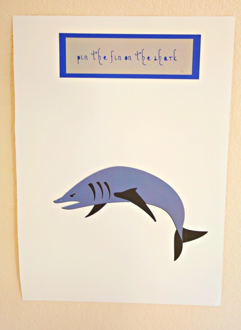 DIY Pin the Fin on the Shark game made with the Cricut Maker - perfect for a super fun shark birthday party #sharkparty #CricutMaker