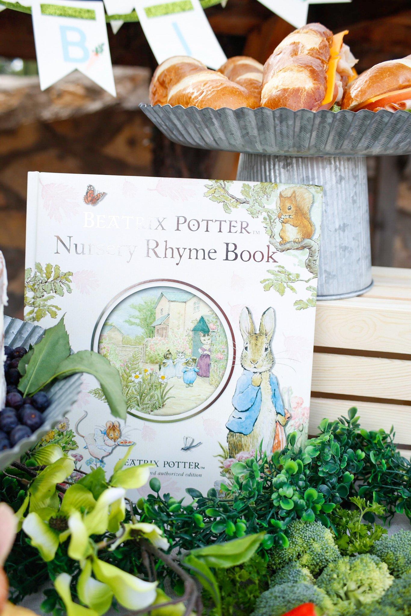 Use books as decor for your Peter Rabbit party - see more fresh ideas for this Peter Rabbit Party at Jordan's Easy Entertaining #WorldMarketTribe #ad