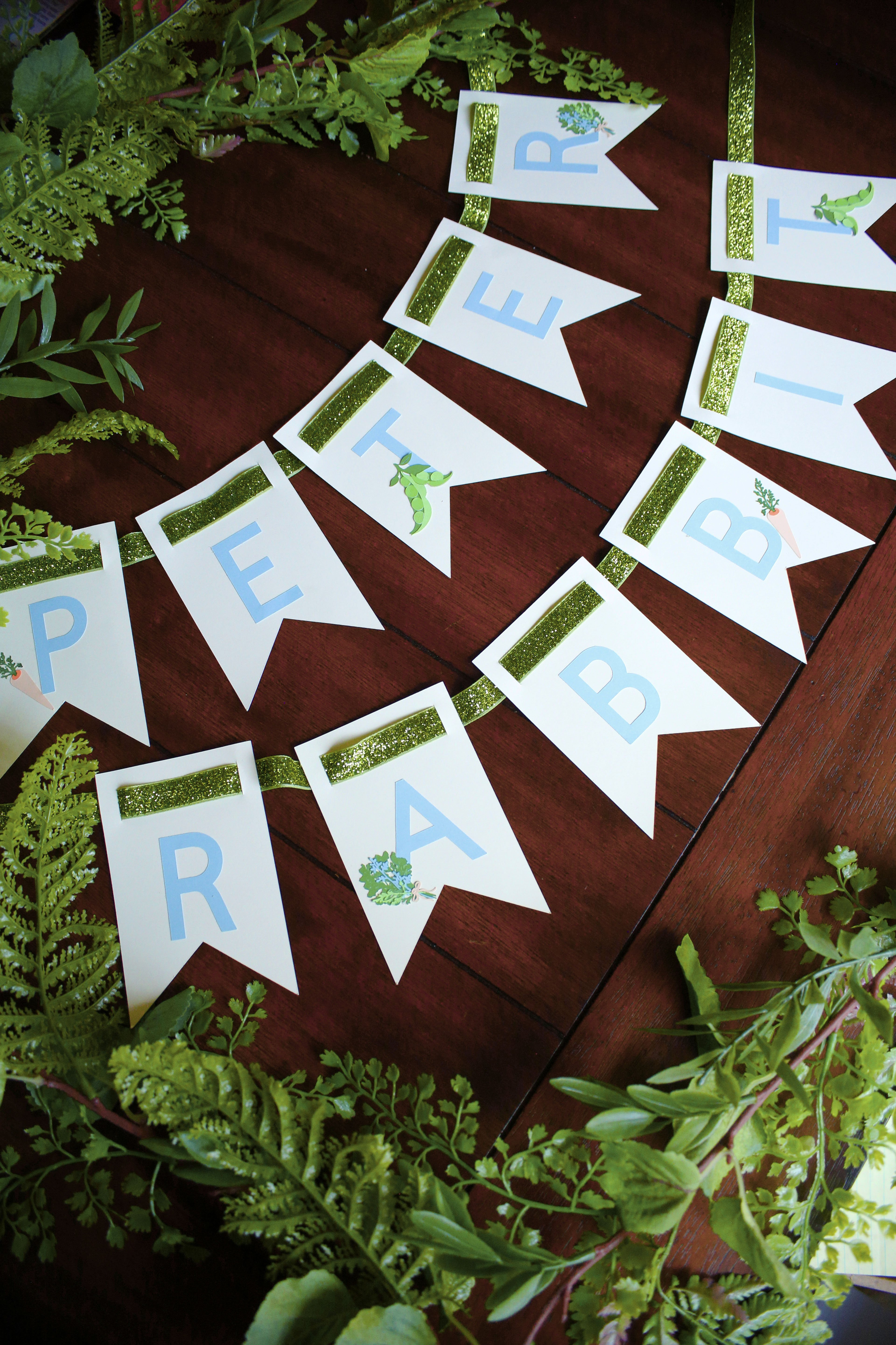 Planning a Peter Rabbit party?  Follow this easy tutorial to make an adorable Peter Rabbit banner using a Cricut Maker.