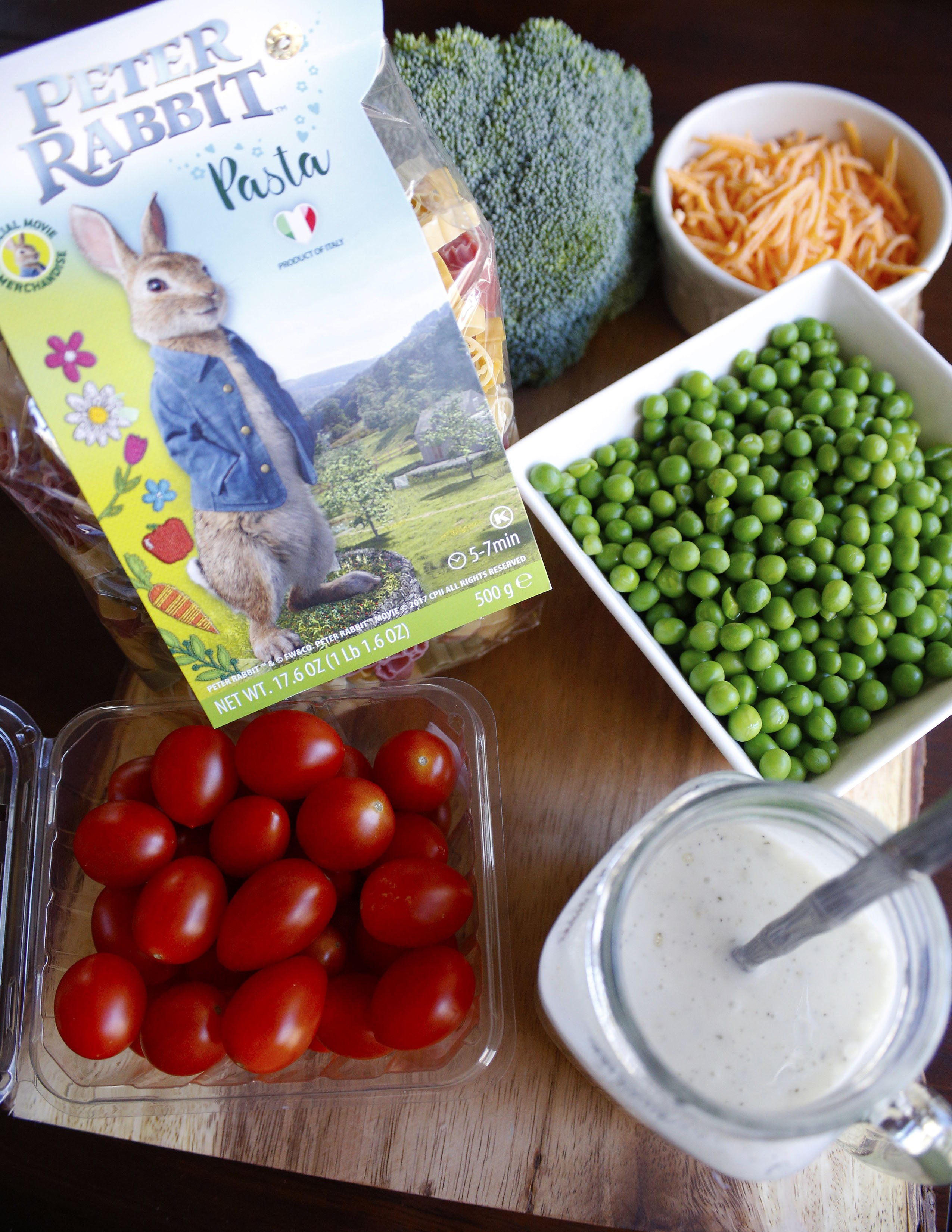 Ingredients for Peter Rabbit pasta salad - bunny shaped pasta, tomatoes, broccoli, cheese, peas, and ranch dressing