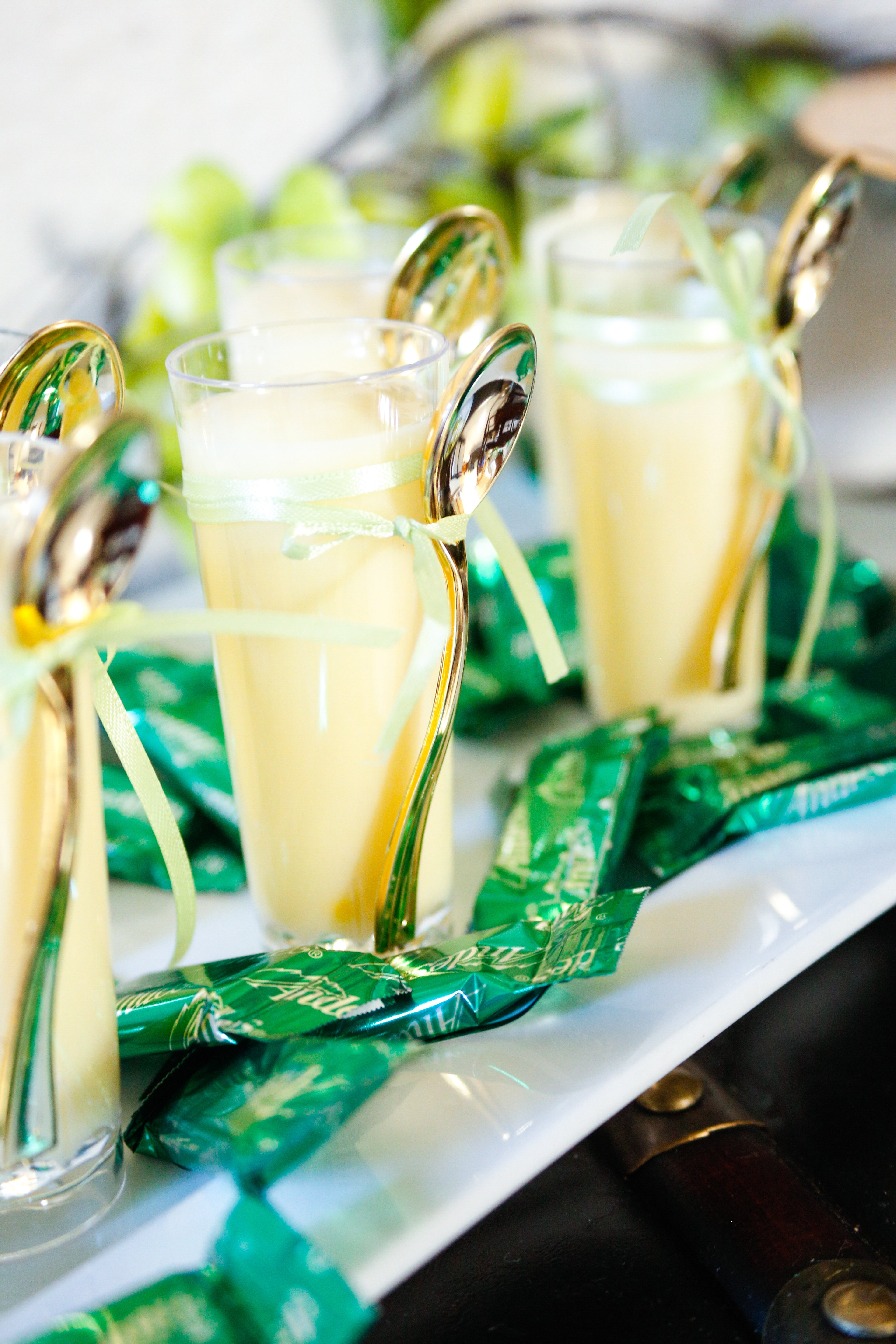Pudding shooters and chocolate mints are a great dessert for serving at a St. Patrick's day dinner party