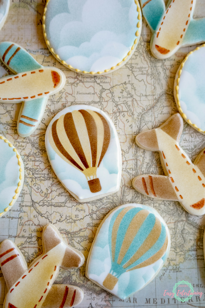 Hot air balloon, air place, and cloud cookies for a travel themed baby shower