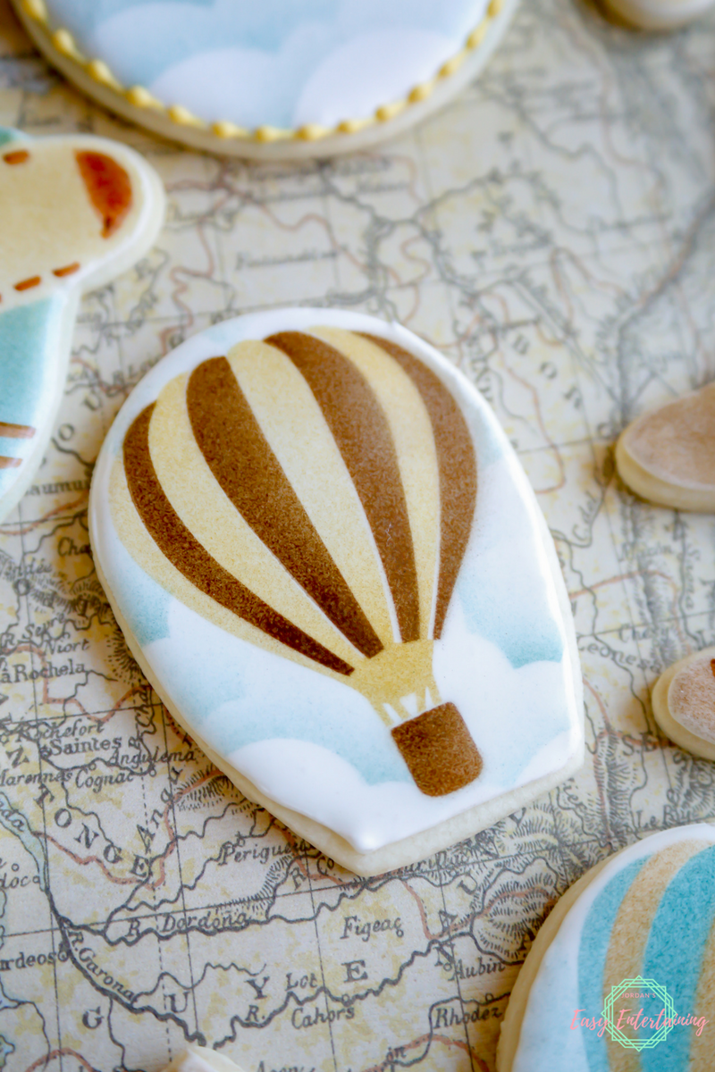 A quick and easy tutorial on decorating these hot air balloon cookies for a vintage travel themed baby shower