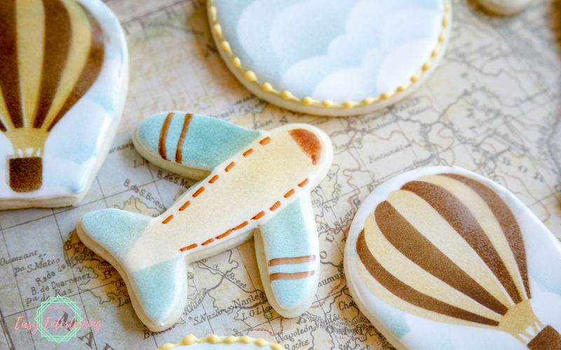air plane cookies for a vintage travel themed baby shower plus a tutorial on how to make them