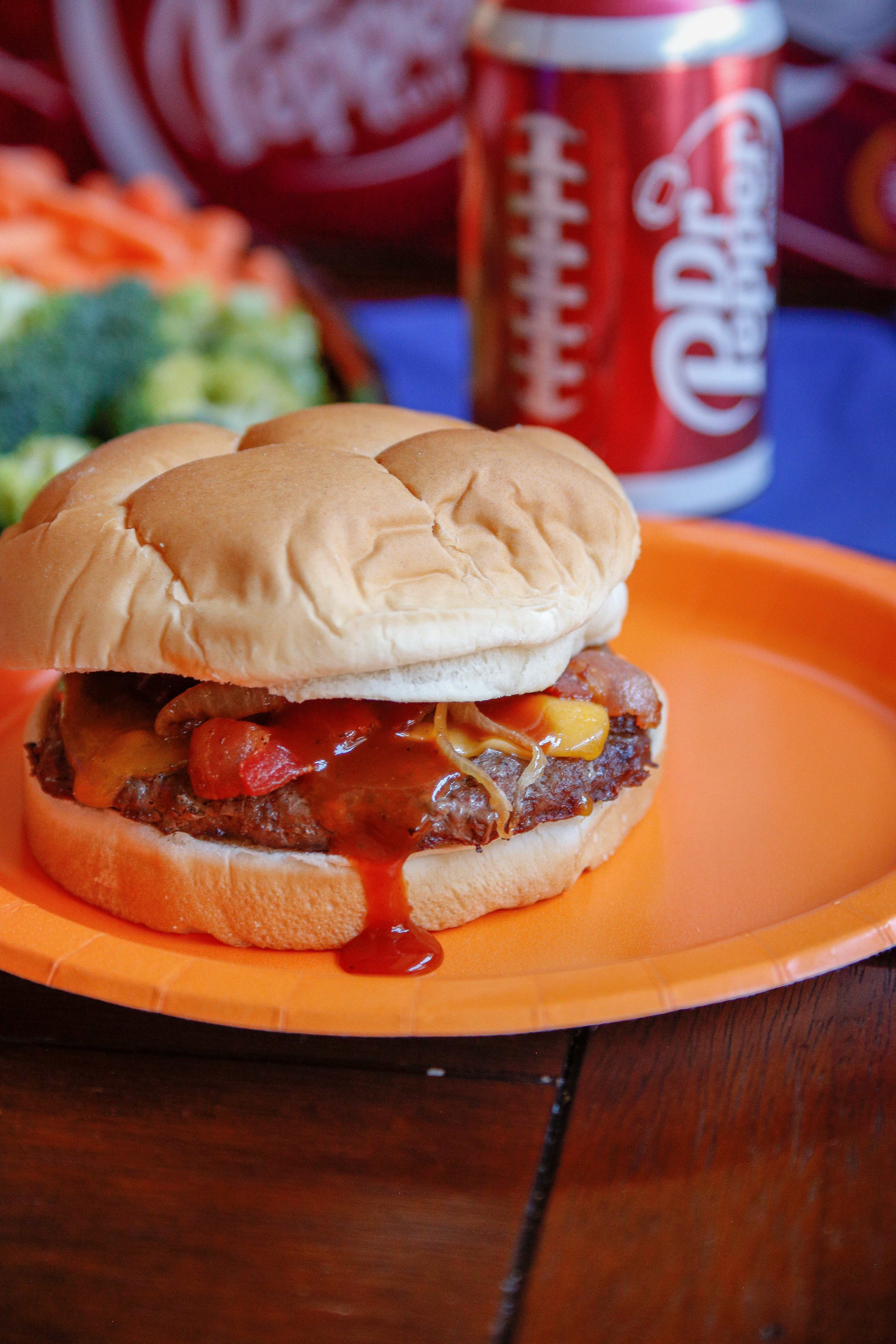 Throw the ultimate College Football homegating party with these fun ideas and a barbecue bacon cheeseburger recipe #FootballFanGame #FiredUpFans @drpepper @walmart @kingsford #ad