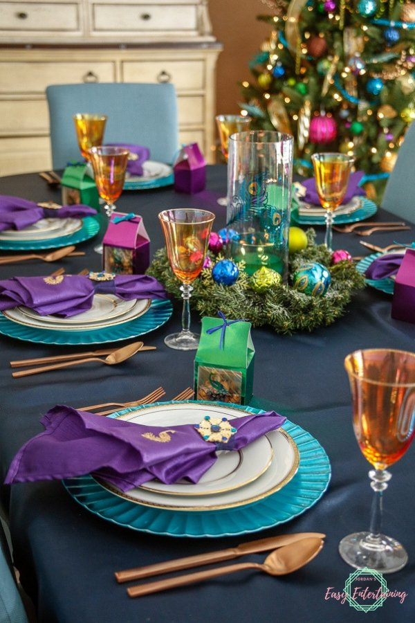A tablescape featuring peacock themed diy Christmas table decorations #ad # Cricut