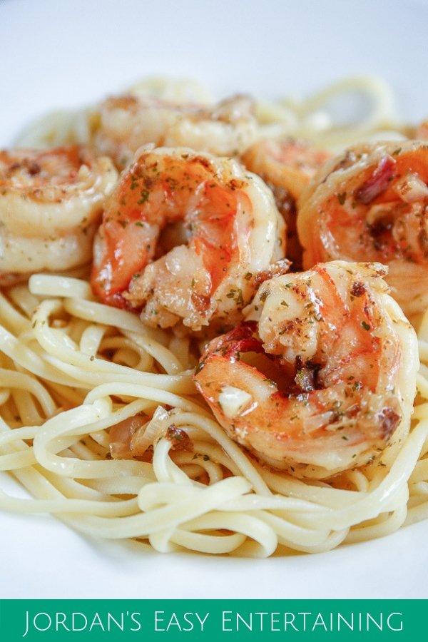 shrimp scampi on a bed of buttered linguini