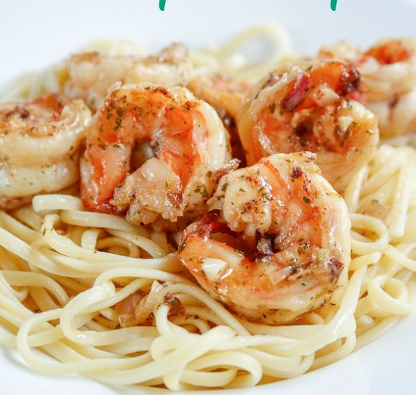 sauteed shrimp scampi over a bed of buttered linguini with the text easy shrimp scampi