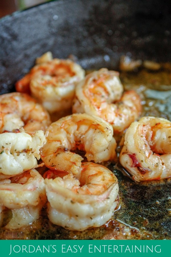 shrimp sauteed in a butter garlic wine sauce in a cast iron skillet