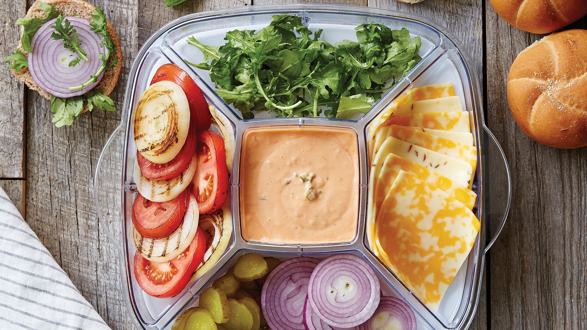 toppings for burgers in a chilled serving dish