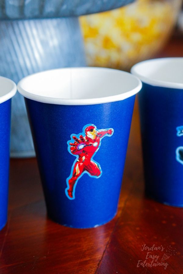 a dink cup with an Iron Man sticker