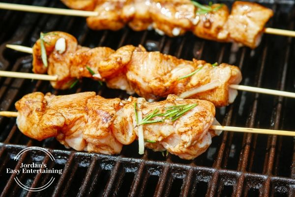 cooking chicken kabobs on the grill