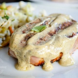 grilled pork chops topped with a sage mustard cream sauce