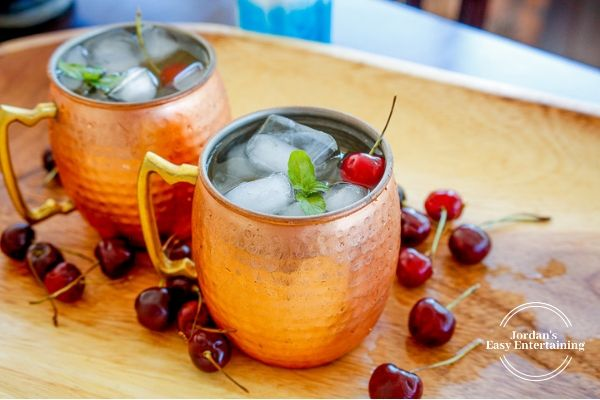 Smirnoff vodka mixed drinks served in a copper Moscow Mule cup with ice, mint, and cherries
