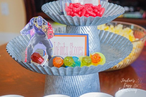 ring pops on a cake stand to make Infinity Stones for an Avengers family movie night
