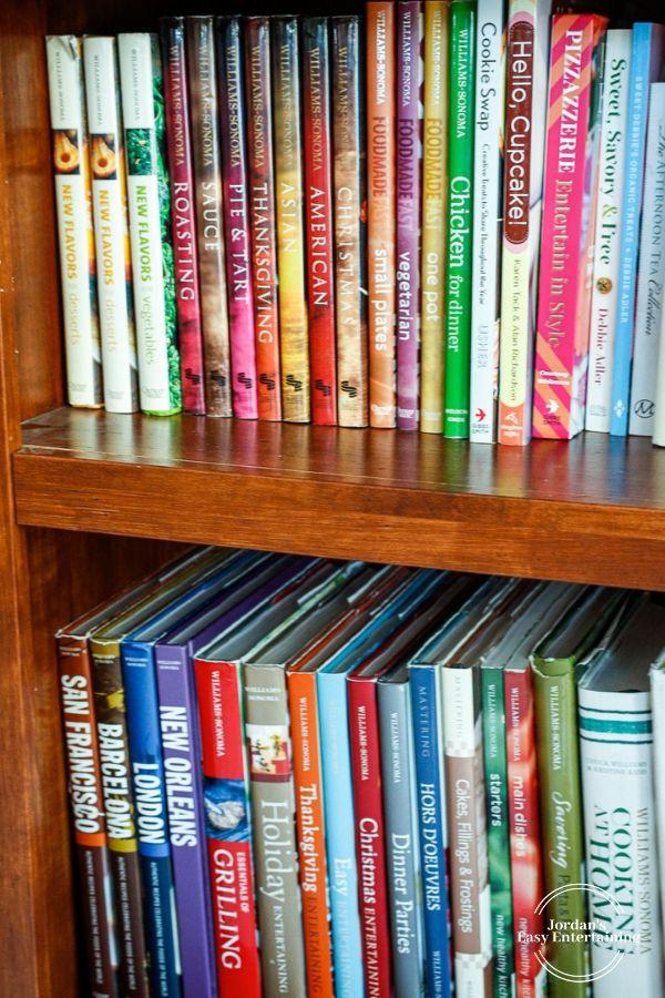 Williams Sonoma cookbooks on a bookcase