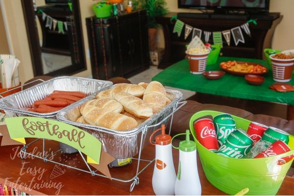 a football party with a hotdog bar and football party decorations