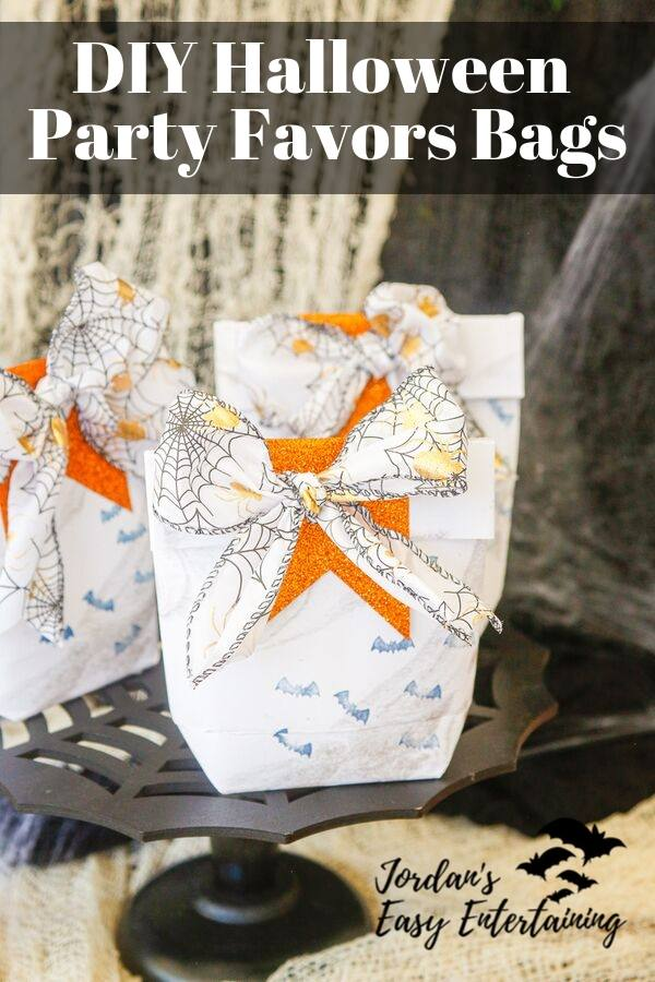 A super easy diy Halloween party decoration - these diy party favors bags are made from paper and ribbon