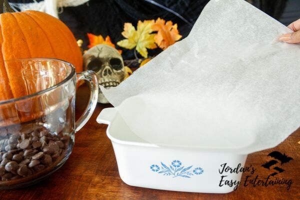 line a baking dish with parchment paper for this Halloween dessert recipe
