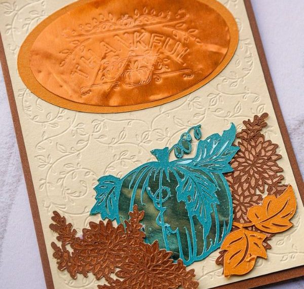 a homemade thank you card with pumpkins, flowers, and leaves
