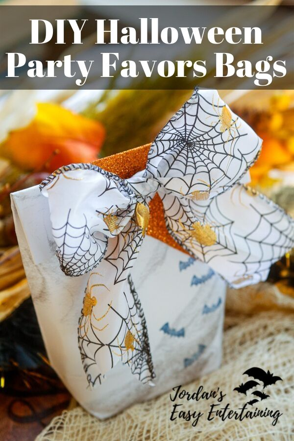 a diy party favor bag made from paper and ribbon for a Halloween party