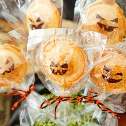 jack-o-lantern pumpkin pie pops displayed for a Halloween party