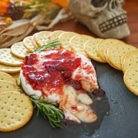 Gooey Baked Brie with Raspberry Preserves Savory Halloween Recipe