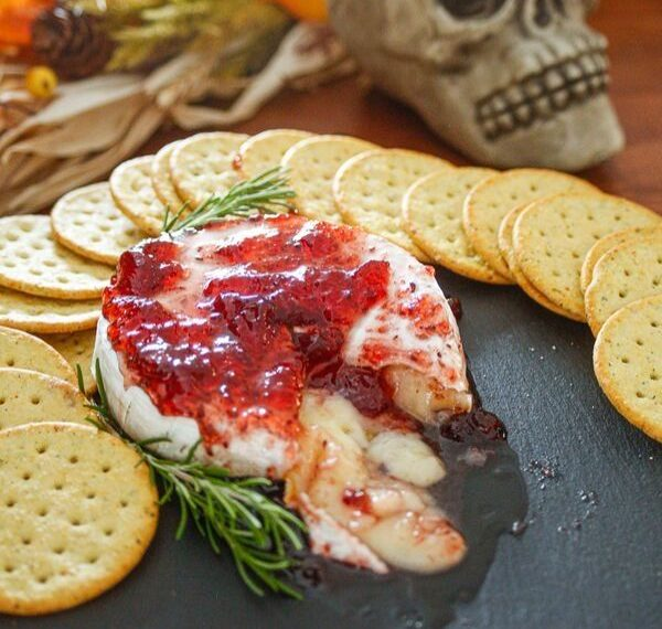 baked brie with raspberry preserves for a savory Halloween recipe
