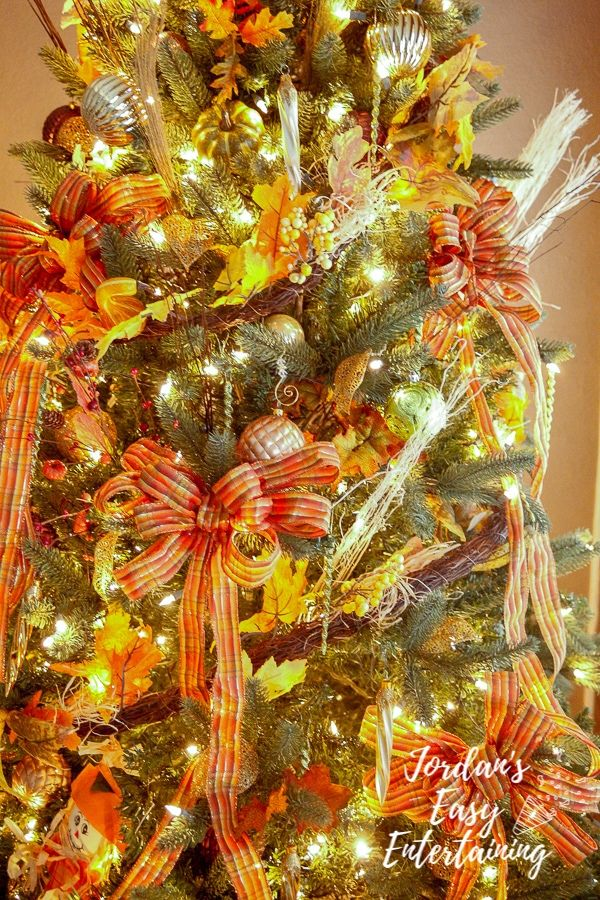 a fall themed Thanksgiving tree also known as a thankful tree as a new Thanksgiving decorations idea
