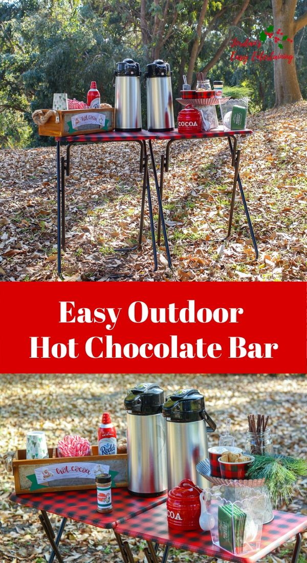 an easy outdoor hot chocolate bar setup in the woods for Christmas