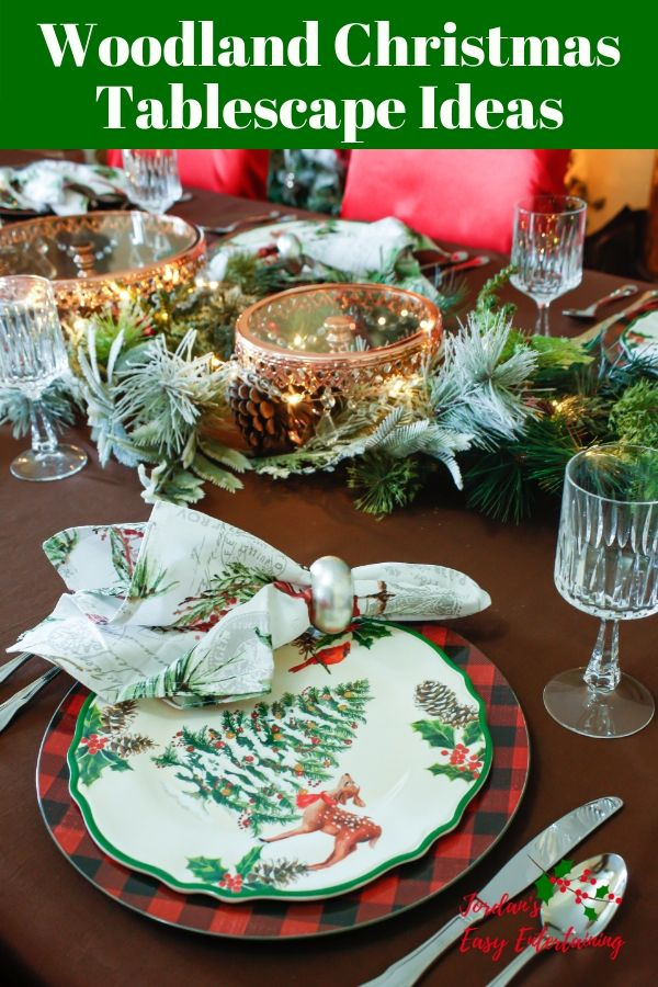a Christmas tablescape with buffalo plaid chargers, Christmas tree plates, and garland