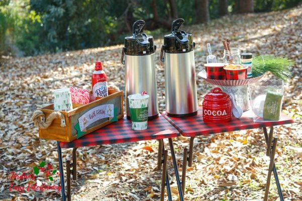 a hot cocoa bar setup in the outdoors