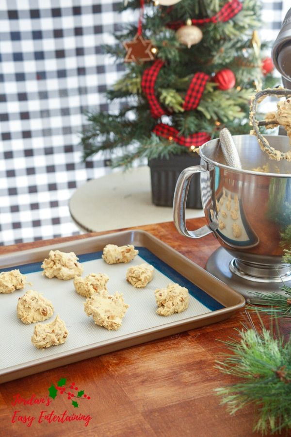 a tray of cookies ready for the oven next to a Kitchenaid stand mixer