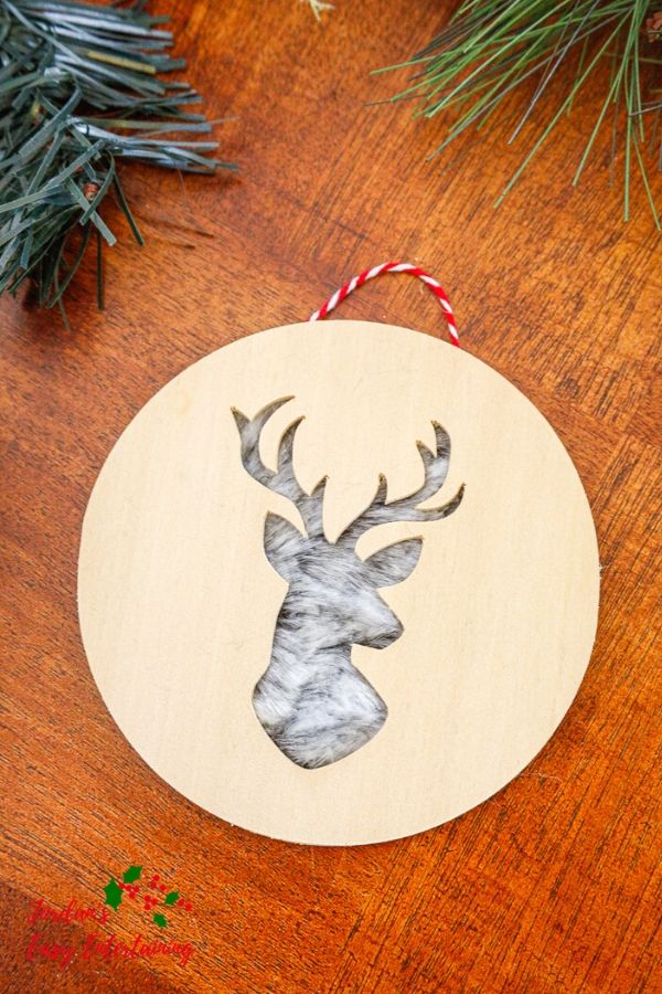 a wooden diy Christmas ornament made with Cricut Maker