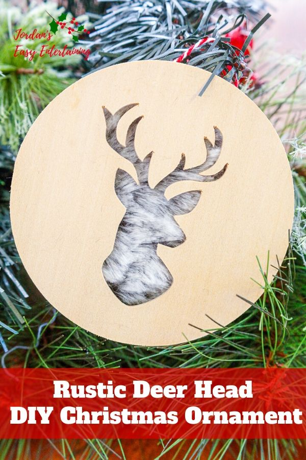 a diy Christmas ornament made of wood with a deer head cutout and fur with text overlay