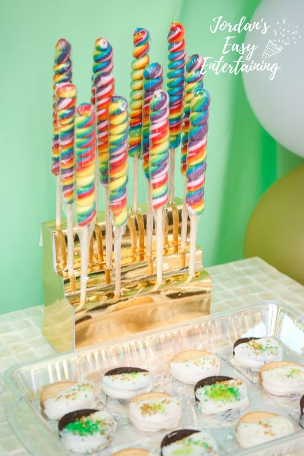 rainbow lollipops in a gold stand